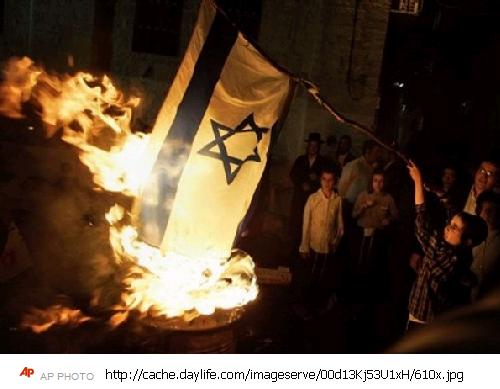 neturei-karta-burn-an-israeli-flag-during-the-holiday-of-lag-ba-omer-in-jerusalem-late-thursday-may-22-2008